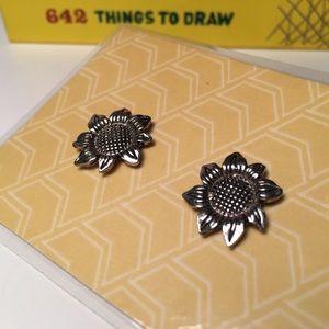 Silver tone metal sunflower stud earrings